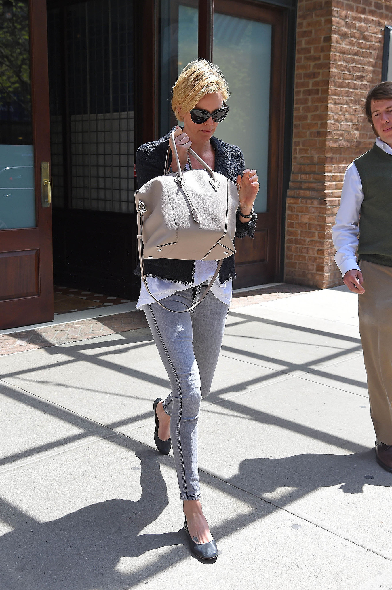 Charlize's off-duty style always feels polished. If she's sporting jeans, you can expect she'll refrain from sloppiness with a tailored blazer.