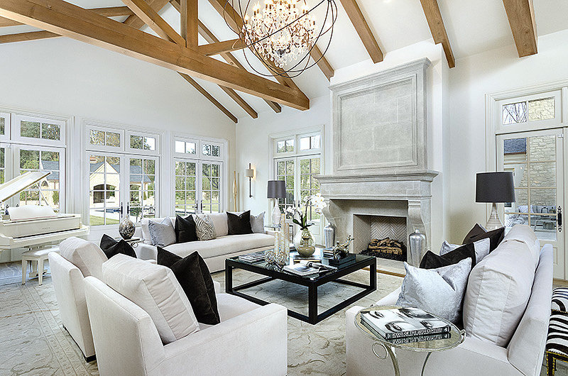 With a family as large as Kim's, a large living space is a must. Aren't the wooden ceiling beams incredible? Source: Zillow