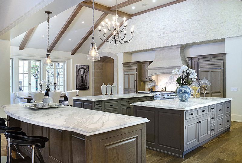 The Wests won't be wanting for counter space thanks to this property's three marble-topped kitchen islands.  Source: Zillow