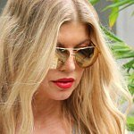 "Fergie finds son Axl's French kissing to be ""delicious"""