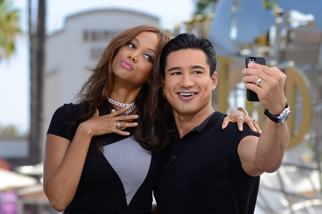 Tyra Banks and Mario Lopez took a photogenic selfie while filming Extra in LA on Wednesday