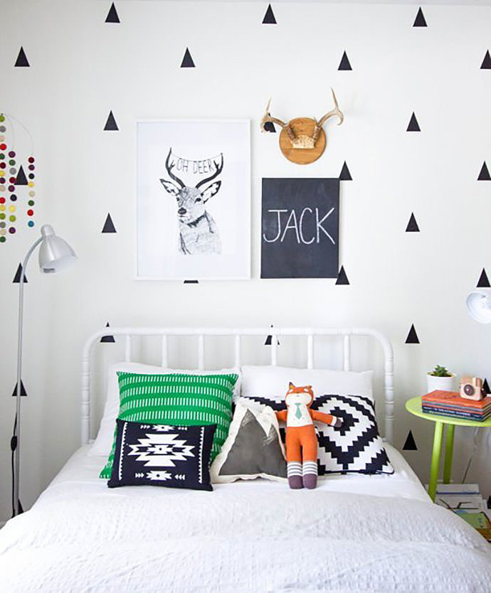 Chalk­boards make great name wall dec­o­ra­tions, too: Last but not least, if you pre­fer to keep things sim­ple, why not just write your lit­tle one's name on a chalk­board like Ginny Chase? This wall dec­o­ra­tion stands out so well in the mod­ern, graphic black and white space she designed for her son, and her idea can be cus­tomized to the style of any room. Chalk­board paints exist in var­i­ous col­ors, and you could even try using one board per let­ter.