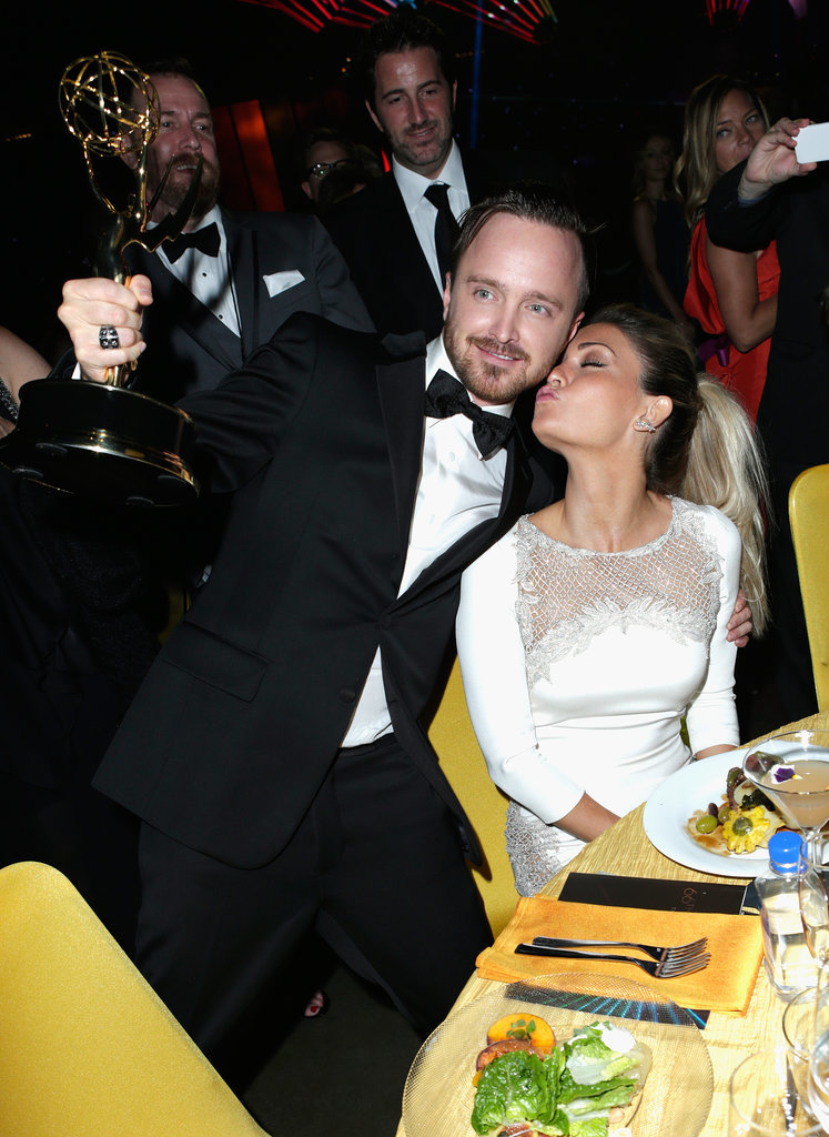 Aaron Paul got a sweet smooch from his wife, Lauren Parsekian, during the Governors Ball.