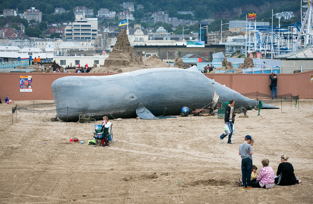 Beachgoers snapped photos of an inflatable whale that was erected by the Bible Society in the UK.