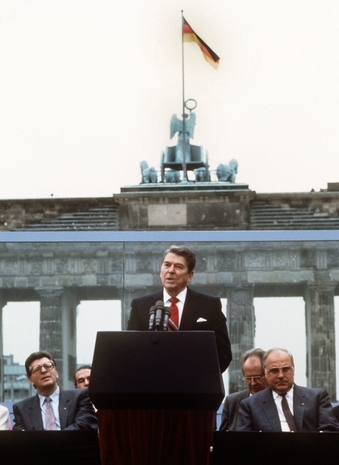 President Reagan acknowledges the crowd after his speech in front of the Brandenburg Gate in West Berlin on June 12, 1987 , where he said Mr. Gorbachev, tear down this wall!'