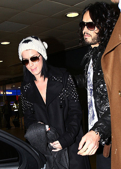 Russell Brand picks up girlfriend Katy Perry as she arrives at Heathrow Airport in London