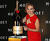 Slide Photo of Scarlett Johansson With Big Bottle of Champagne