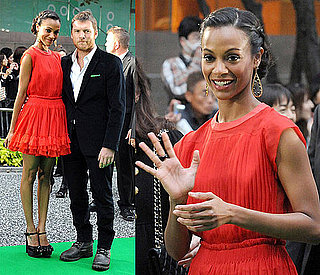 Zoe Saldana Attends Tokyo Film Festival in an Red Orange Ruffle Dress and Black Platforms