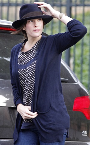 Liv Tyler Wears Navy Cardigan and Hat in WIndy New York City