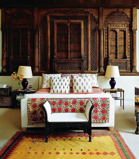 Decorator Matthew Patrick Smyth installed an 18th-century Moghul façade from a merchant's house as a headboard in the master bedroom of a documentary-filmmaker client in London; the hand-blocked fabrics are from India, and the suzani is 19th century. Photo: Simon Upton