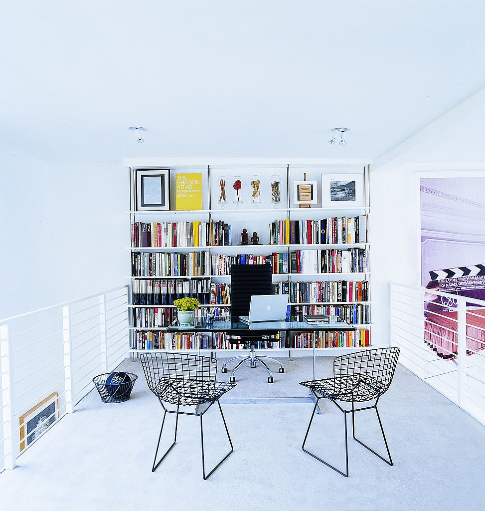 Entrepreneur Will Kopelman's West Hollywood loft features a mezzanine home office, where he works at a desk purchased by his father, Arie L. Kopelman, in the 1960s; the wire chairs are classic Bertoia. Photo: Simon Upton