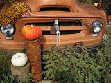 San Francisco gardening store Flora Grubb decorated a classic truck (in a very seasonally appropriate color) with pumpkins and an understated skeleton. Try adding small touches like this if you're a bit Halloween-decoration phobic.