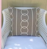 This Linking Rings 20-inch Pillow ($35) from Swoon Studio is classic and versatile.
