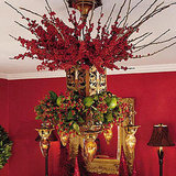 For instant holiday style, decorate an existing chandelier with berries and branches.