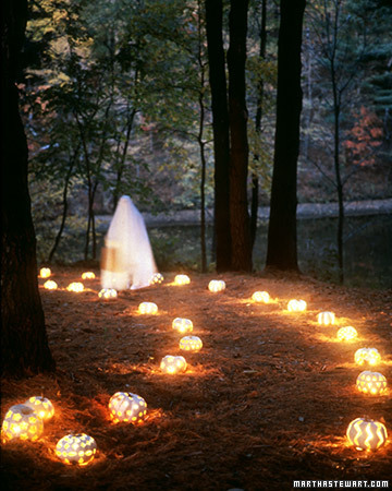 Light up a walkway with small, carved pumpkins to create moody, ambient light.