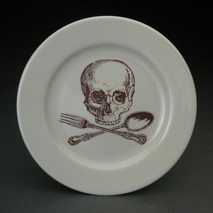 Give your guests service with a skully smile with this Skull and Cross Utensils Plate ($14).