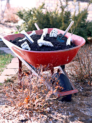 Fill a wheelbarrow with a heap of dirt and plastic bones to give your lawn the look of an eerie graveyard shift!