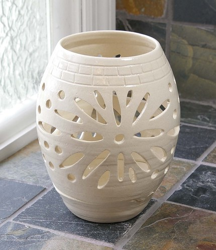 This Large Handmade Votive Lantern ($65) has a lively sunburst pattern that's ideal for modern or traditional homes.