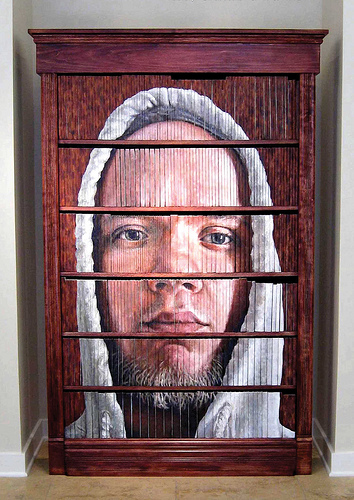Artist Craig Paul Nowak painted this portrait on a bookshelf full of books.