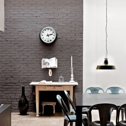 A lot of people tend to paint their exposed brick walls white, if they do at all. But gray is so neutral that it can also handle the pattern and texture of the brick without feeling overbearing. Source