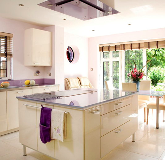 Lavender countertops are an unexpected, lively statement in this kitchen. Source