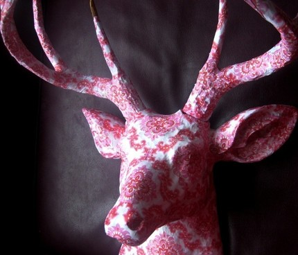 Even deer can look pretty in pink, with this Pink Flocked Deer Head ($375). It's covered in paper over a resin mount.