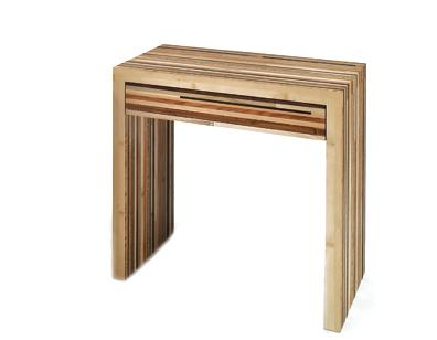 This Side Table (inquire for price) has a similar natural look and shape, and is made of recycled wood scraps.