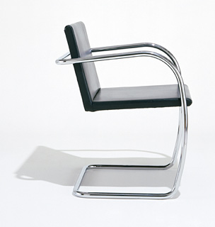 Ludwig Mies van der Rohe's classic Tubular Brno Chair is the standard, in my opinion, on which all tubular chrome furniture is based. Simply beautiful.