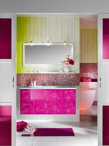 Bright pink lacquered cabinets keep this bathroom modern and full of energy. Source