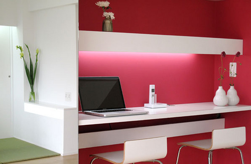 A corner office in this home is delineated by the energy-filled pink wall. Source:  Flickr User BAKOKA