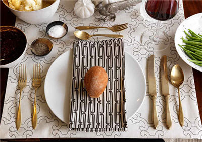 Brilliantly patterned napkins and tablecloths will make your table setting pop. Source