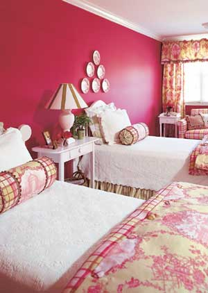 Hot pink can work with more traditional styles. This French country bedroom gets infused with modernity thanks to the wall color. Source