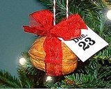 Hang walnut shells enclosing a very small gift on your tree to count down the days.