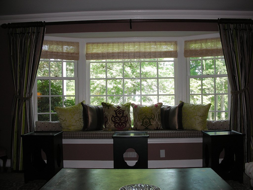 Shades of brown abound in this window seat area.