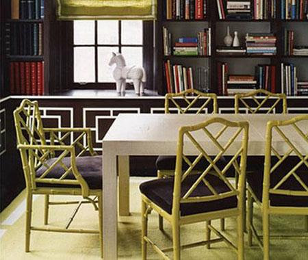 Jonathan Adler used a poppy citrine shade for these chairs, which provides an unexpected contrast to the brown shelving unit. Source