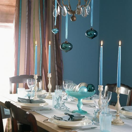 Hang your ornaments from the chandelier above your dining table with silk ribbon. Source