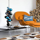 String a bundle of ornaments of various sizes on a cord hanging from the ceiling to make a quiet corner a focal point. Source