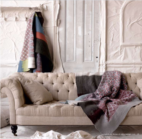 Infuse color and pattern into a neutral sofa by draping luxurious, warm throws across it.