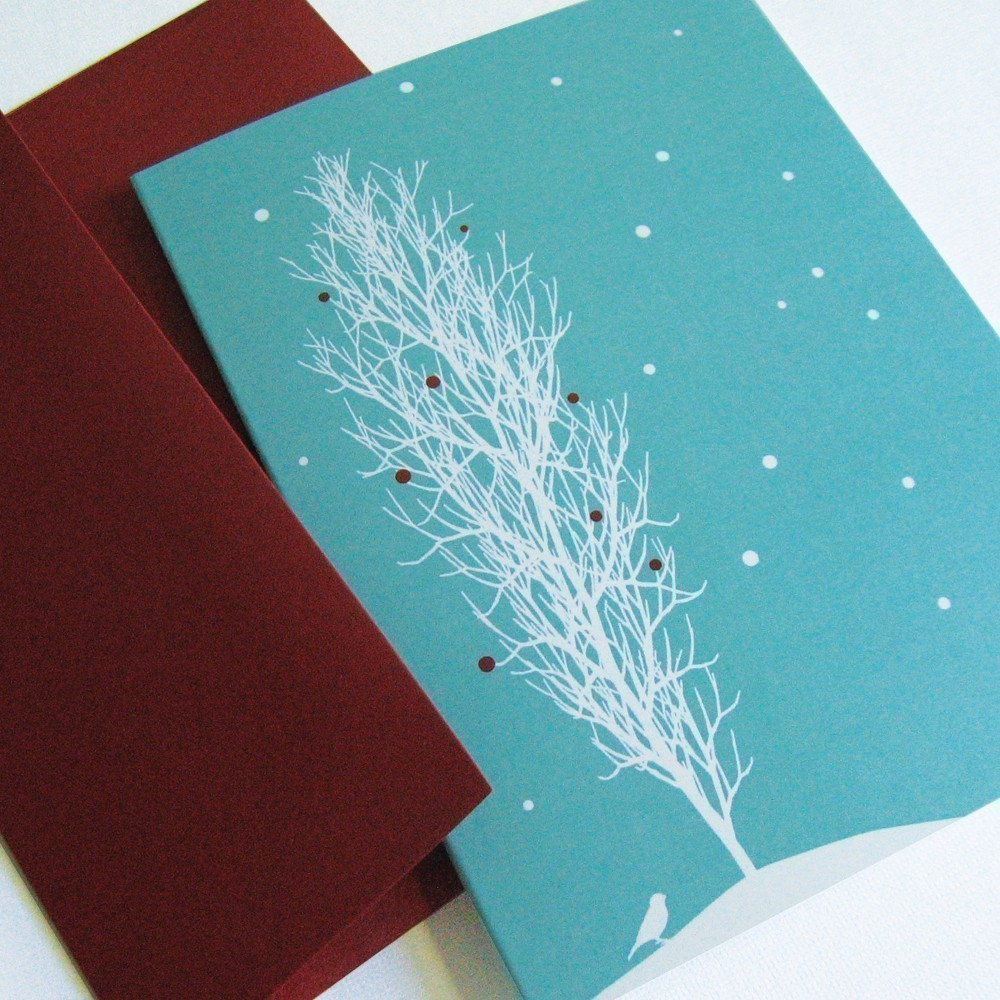 The edgy color scheme on this Snowfall Tree Card Set ($33 for 24) will appeal to design-philes with its modern sophistication.