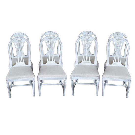 Try adding some Swedish Gustavian Dining Chairs ($3500 for a set of 8) to your house, or whitewash dining room chairs you already own or pick up at a flea market.