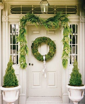 If you have urns, add small evergreens to them to ring in the season. Source