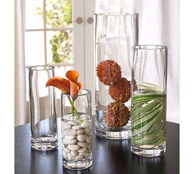 You don't have to splurge on a bouquet to have a gorgeous botanical centerpiece. Arrange glass vases of varying sizes on your table and fill them with dried plants, rocks, and some graphic leaves.
