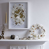 Paper cutouts add an artful look to this mantel.  Source