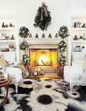 Tall topiaries are perfect for framing a crackling fire.  Source