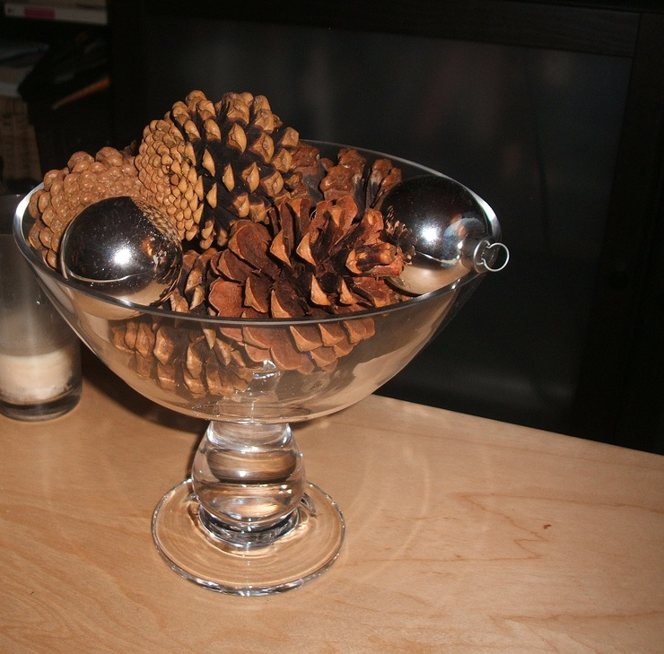 A simple glass bowl filled with pinecones and silver ornaments makes an understated statement. Source: Flickr User petit hiboux