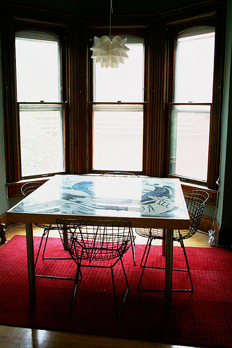 Bay windows are a great place to center a dining room table.