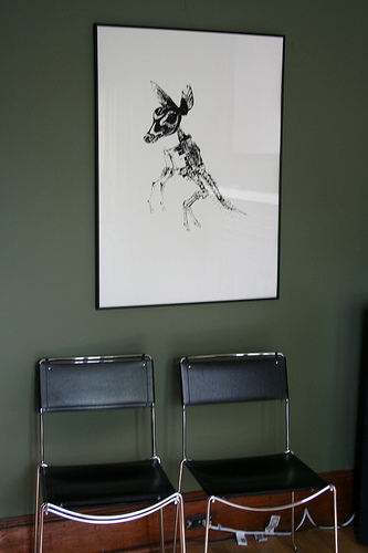 Artwork in the living room is by Nicolas Lampert, a Milwaukee-based artist.
