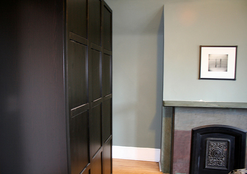 An armoire provides handsome storage in the bedroom.