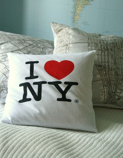 Chez Larsson has a great tutorial for turning old t-shirts into cute pillows.