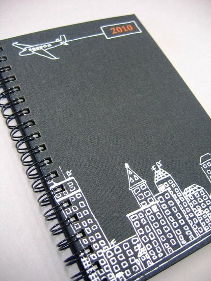 A bit masculine in charcoal and orange, this Nico Paper Goods 2010 Planner ($22) is perfect for the metropolitan dudes you know but looks smart for contemporary gals, too.